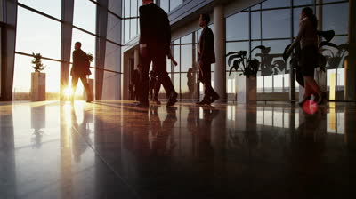 stock-footage-a-diverse-group-of-business-people-are-making-their-way-around-a-busy-modern-office-building-as-the